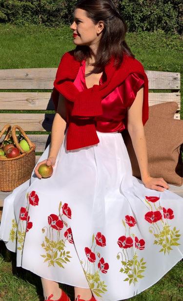 Little wild poppies on white skirt.